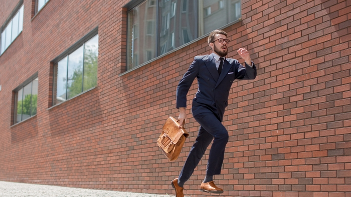 man in a suit running