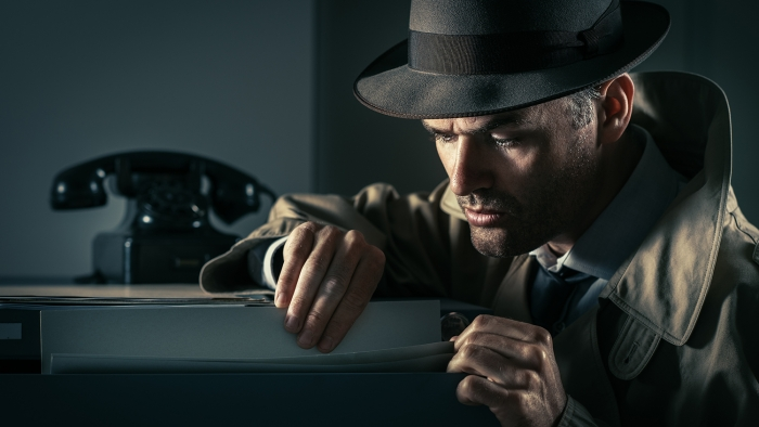 spy with a magnifying glass