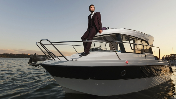 successful man on a yacht